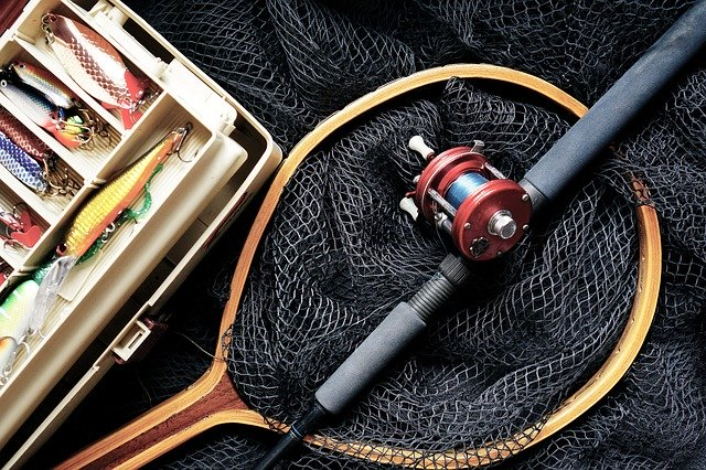 fishing pole, net, and other fishing gear
