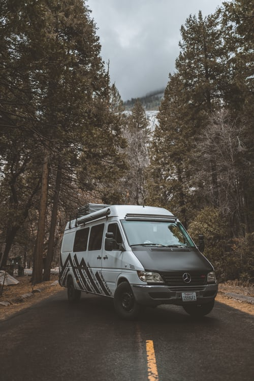 campervan on a forest road