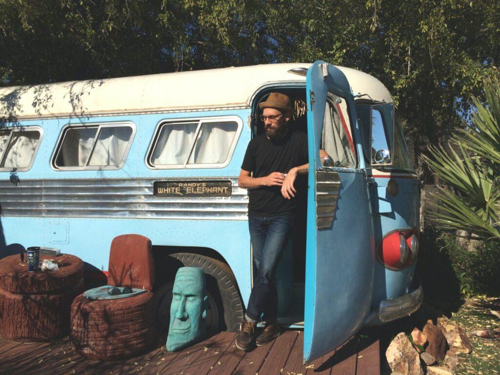 Man stands in the doorway of his VW bus