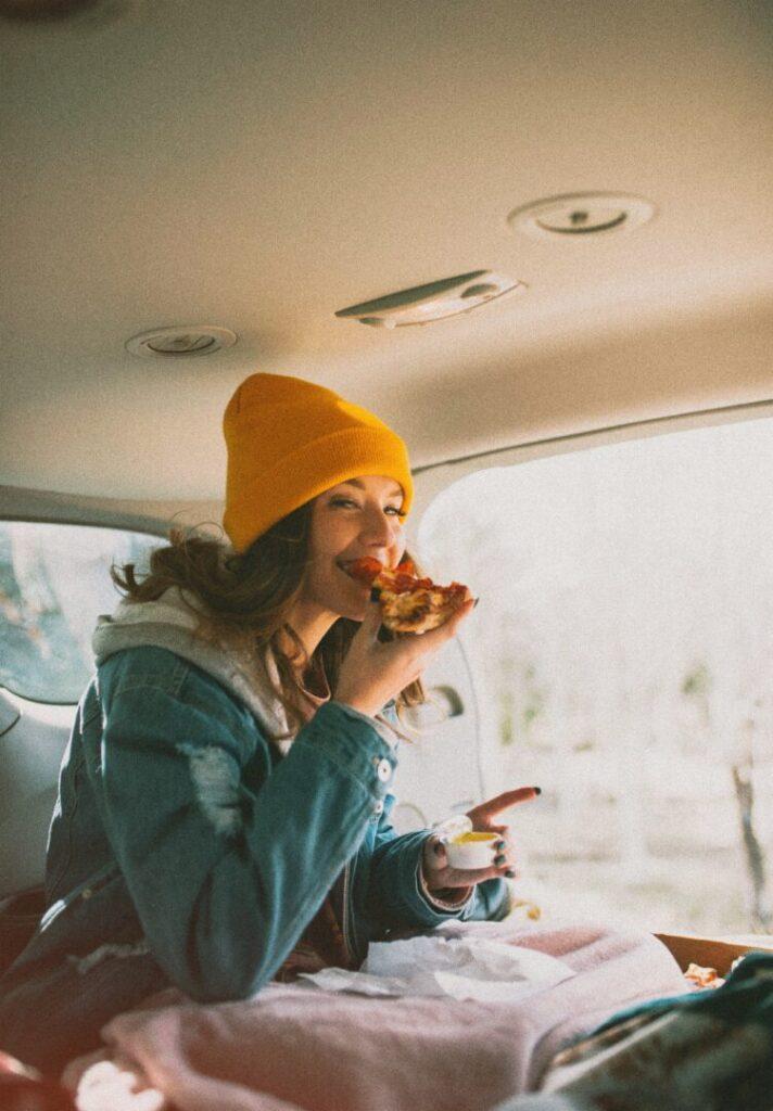 woman eating breakfast in her campervan