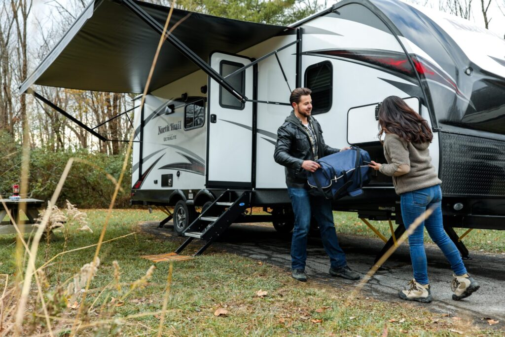 Two People Loading an RV
