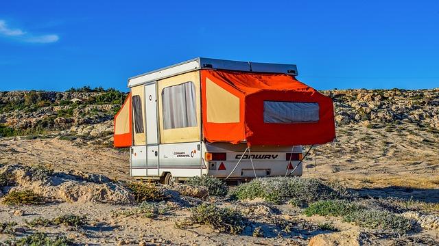 a pop-up trailer set up in the desert
