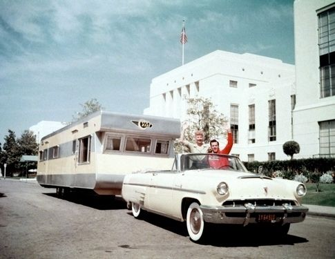 Car hauling a trailer - in the car sits  Lucille Ball and Desi Arnaz