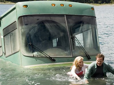 Still frame from the movie RV - the RV has rolled into the lake
