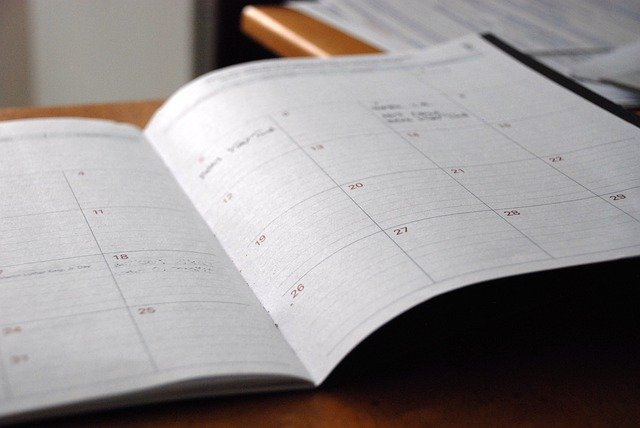 a day planner and pencil