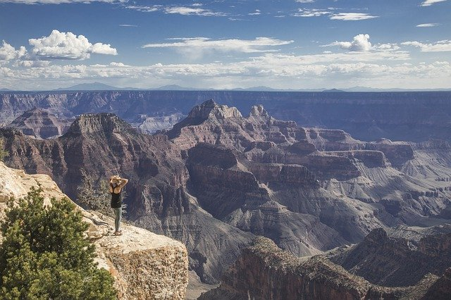 a woman on the edge of the Grand Canyon
