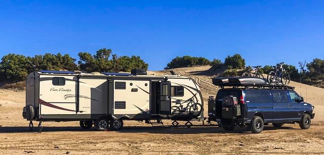 van pulling a trailer in the desert