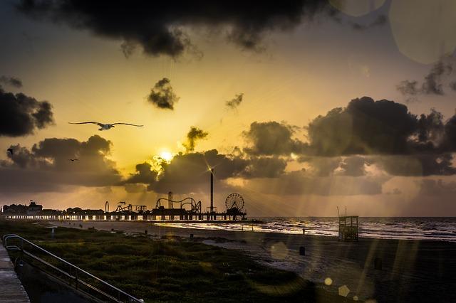 Sunrise over the pier at Galveston Island Texas