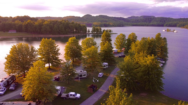 an overhead shot of an RV campground surrounded by a lake
