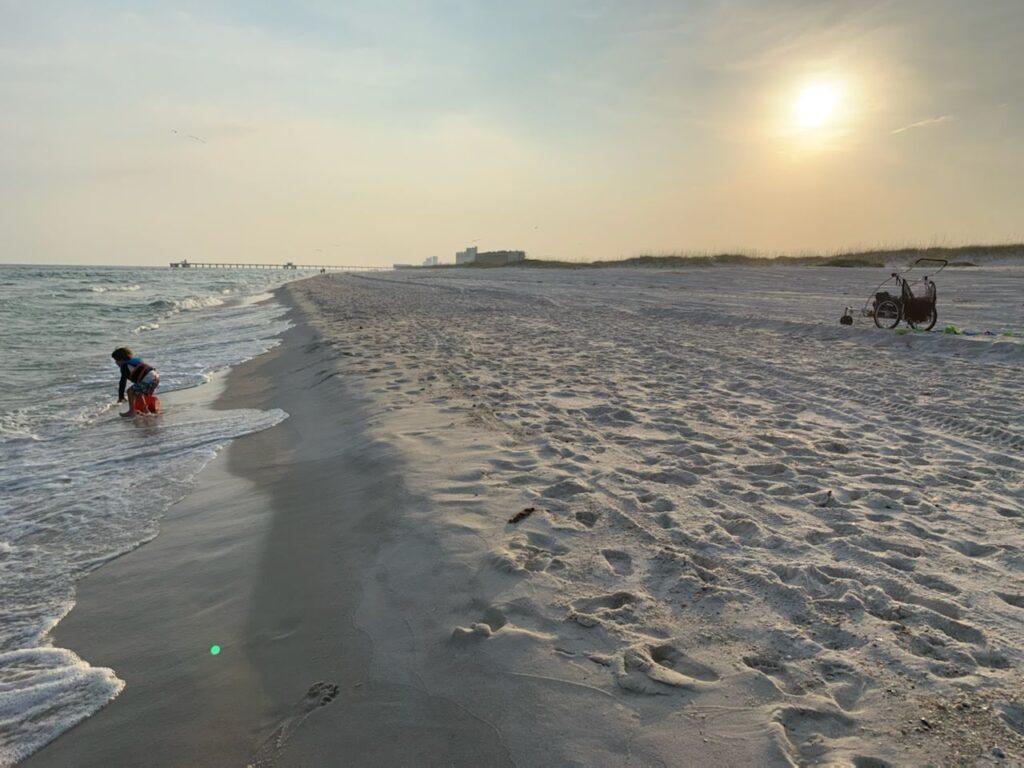 Nearly empty beach at dusk