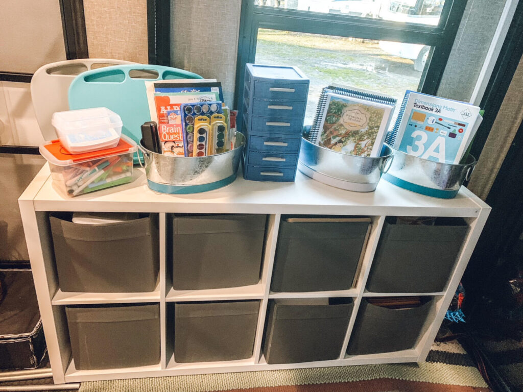 Organizer cubbies with school supplies on top