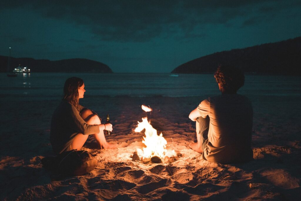 Couple by the campfire