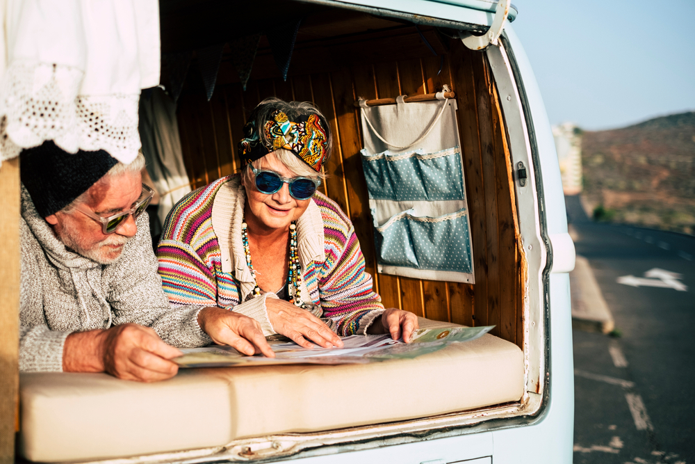 Happy senior couple enjoy the together travel in old vehicle vintage van
