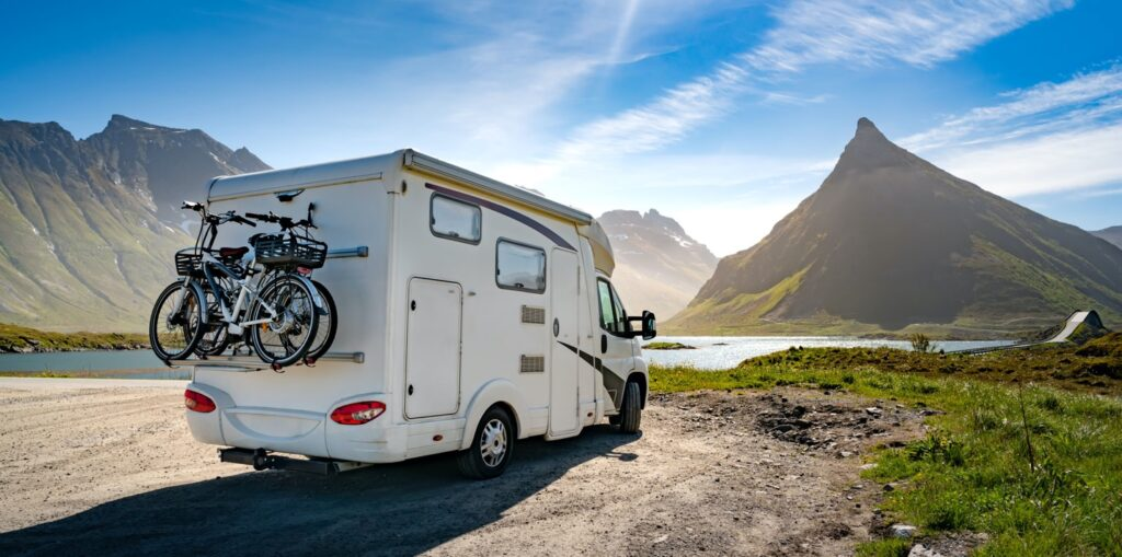 RV with hills and a lake in the distance