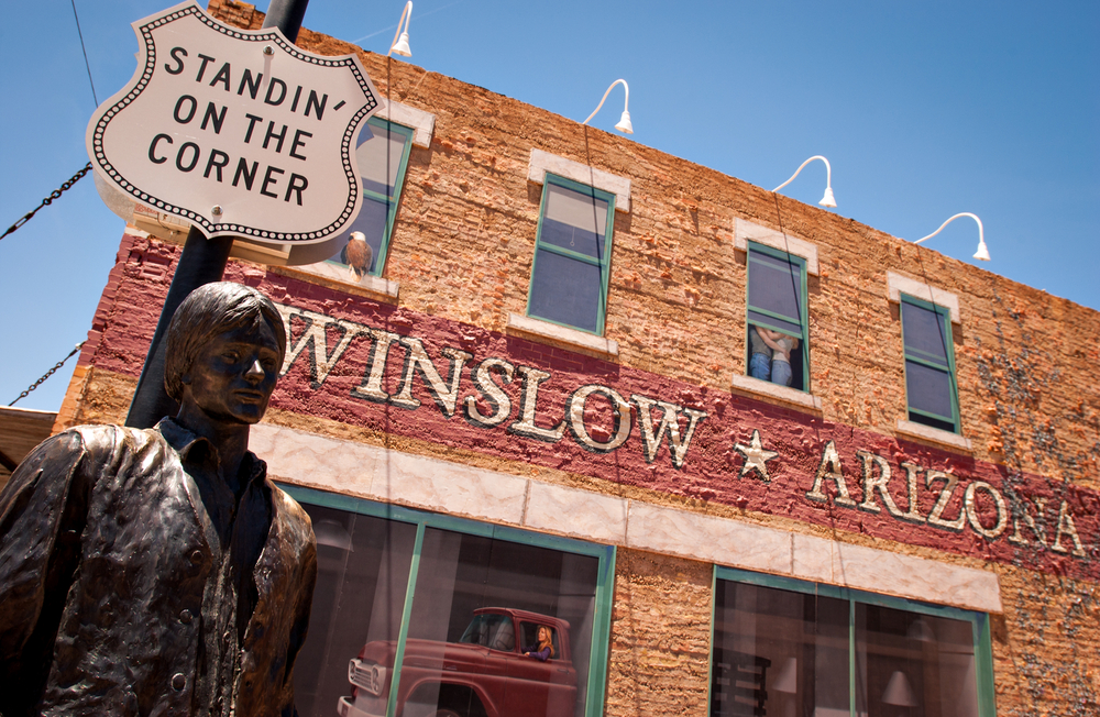 "WINSLOW, AZ/USA - June 13: ""Standin' On The Corner Park"", pays homage to ""Take It Easy"" a song written by Jackson Browne and popularized by the rock group Eagles, on June 13, 2004, in Winslow, AZ."