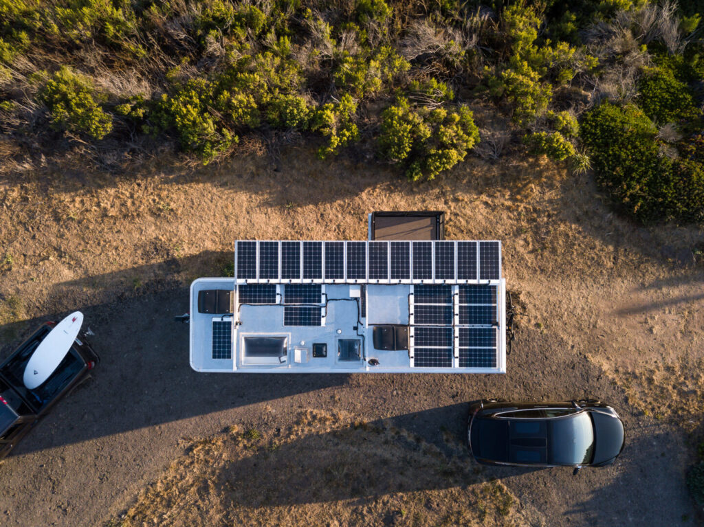 Aerial view of solar panels affixed on the roof of a travel trailer