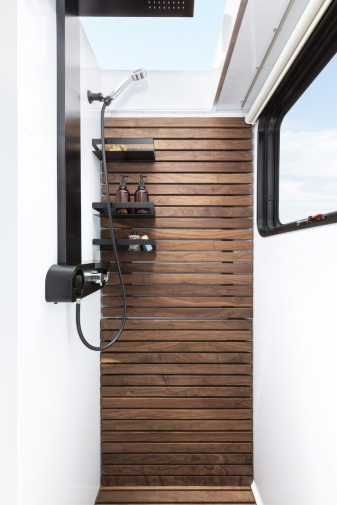 Shower with wood accent inside travel trailer