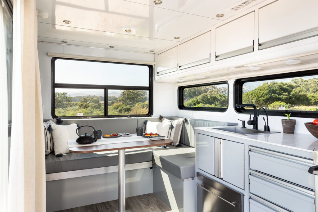 Dining space in corner of kitchen inside travel trailer