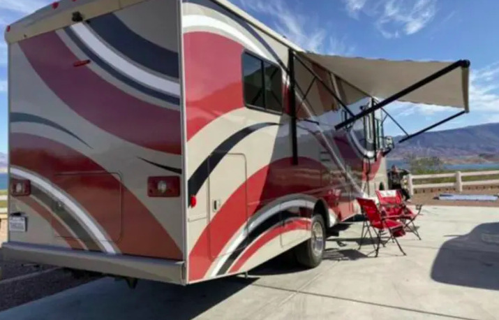 2015 Winnebago Sunstar 31KB set up at a campsite