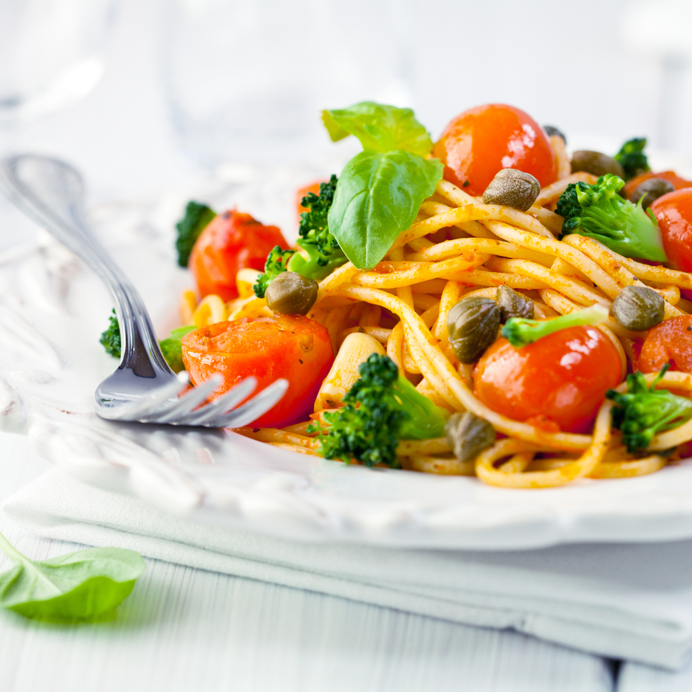 spaghetti with cherry tomatoes, broccoli, capers and fresh basil