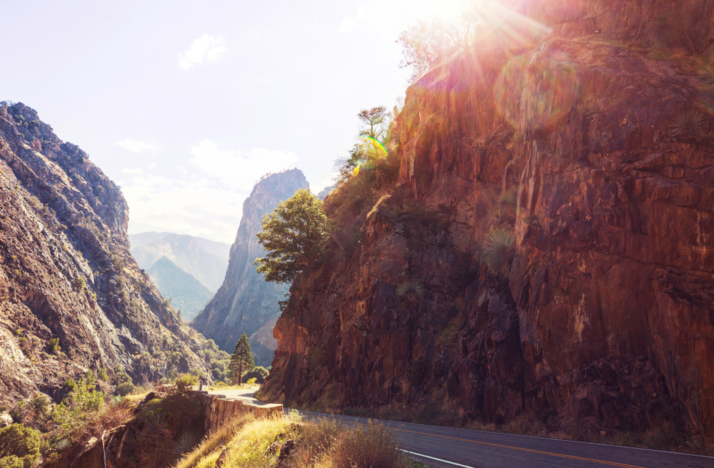 The sun shining on the road through Kings Canyon and Sequioa National Park.