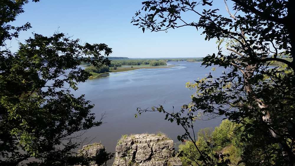 Serene water view of the Mississippi River from a cliff in Palisades State Park