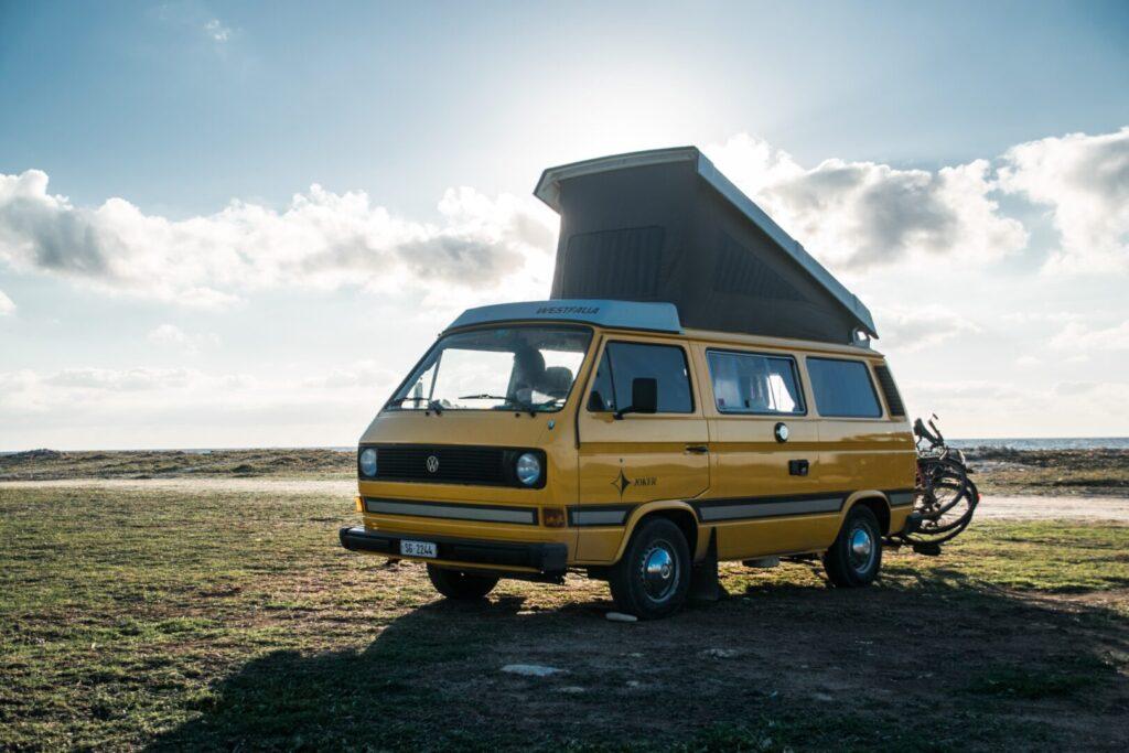 Camper van parked in field