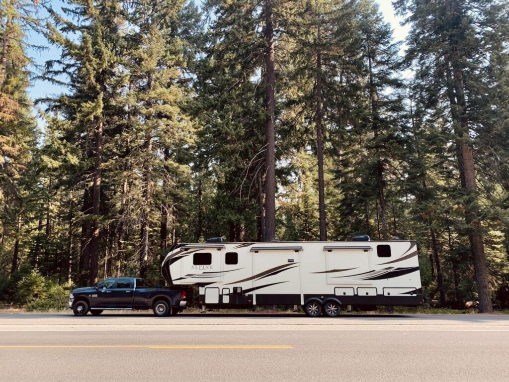 Parked fifth-wheel RV trailer attached to a truck