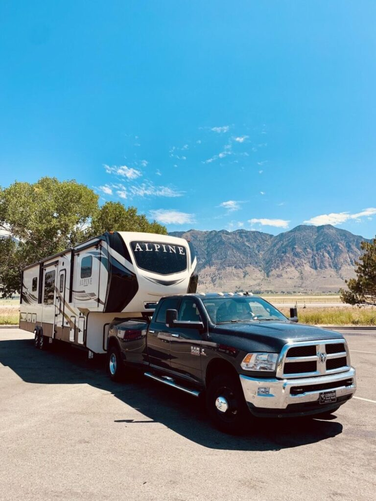 Fifth-wheel RV trailer attached to truck
