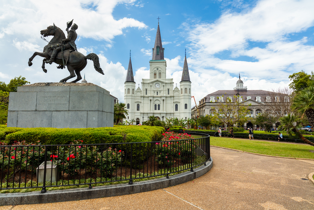New Orleans, LA USA - April 20, 2016: Popular Jackson Square with Andrew Jackson statue and Saint Louis Cathedral in the French Quarter.