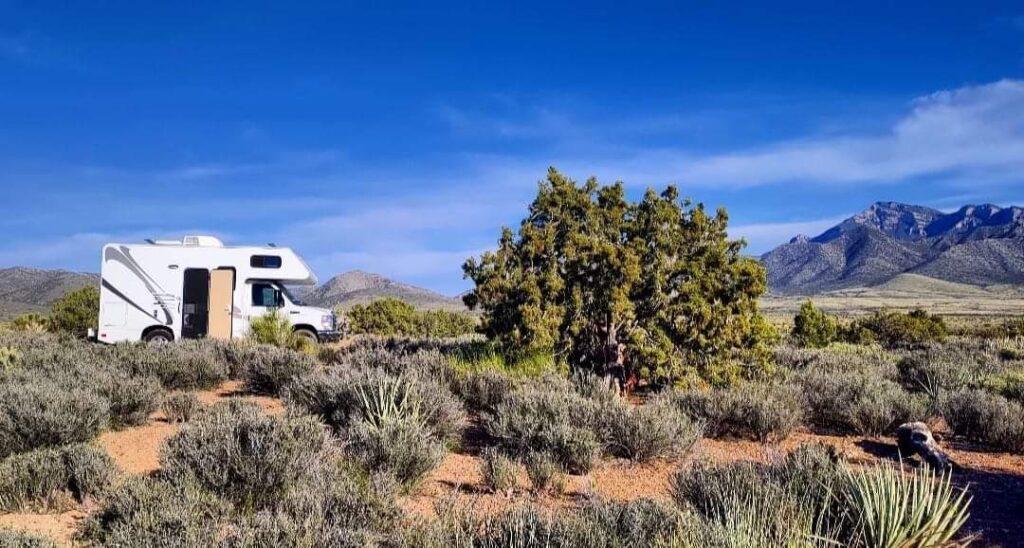 Class C RV parked in a desert landscape