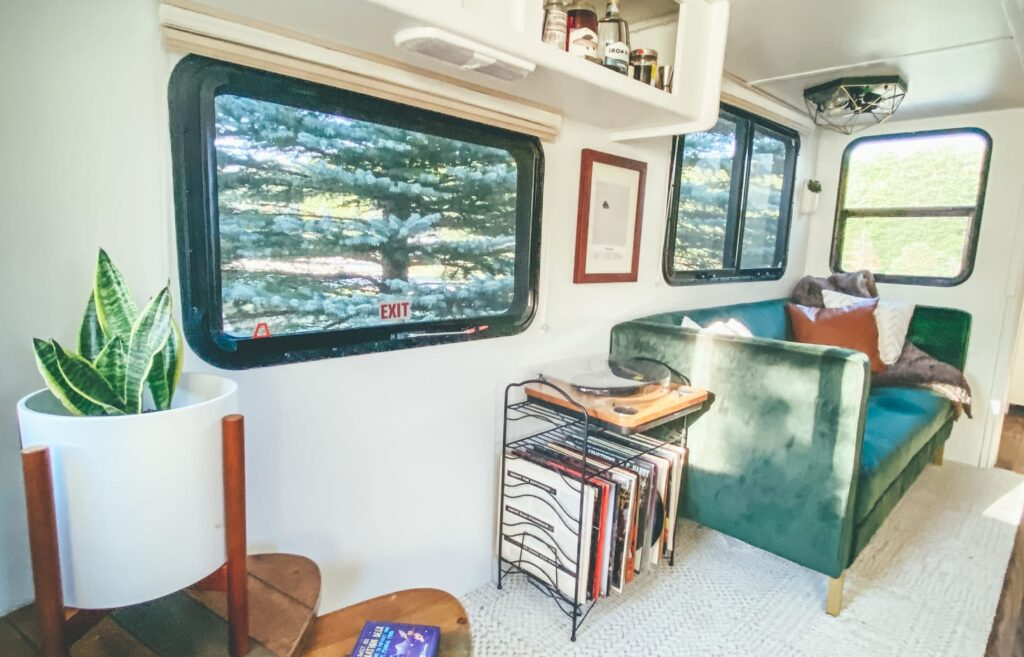 Cozy trailer living area with green couch