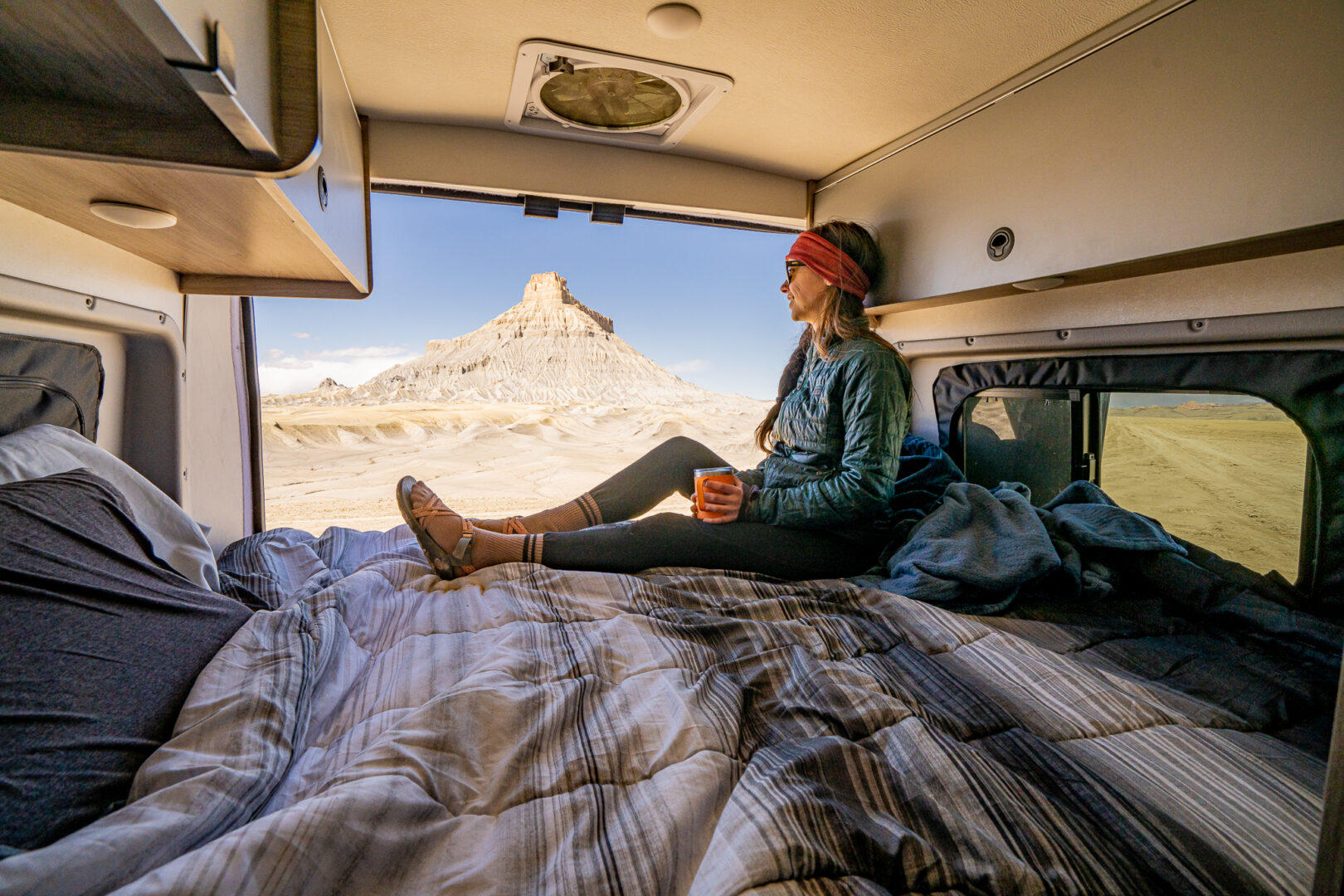 woman in rv with a view of mountains