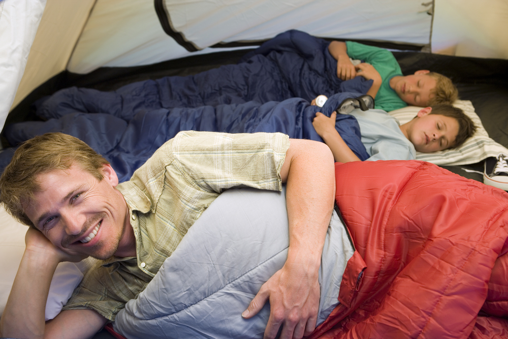 family sharing a tent