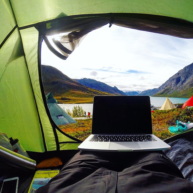 a computer set up at the entrance to a tent