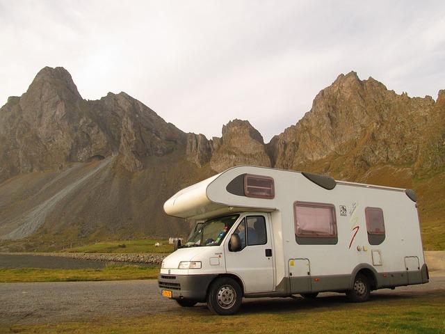 A Class C camper near tall mountains