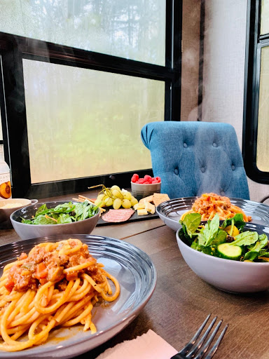 Table set with spaghetti and salad at fifth wheel trailer table