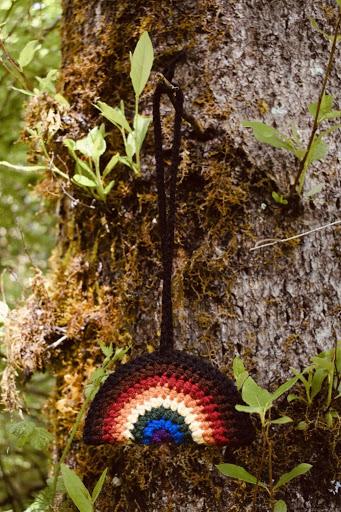 LGBTQIA+ Pride crochet rainbow hangs on a tree