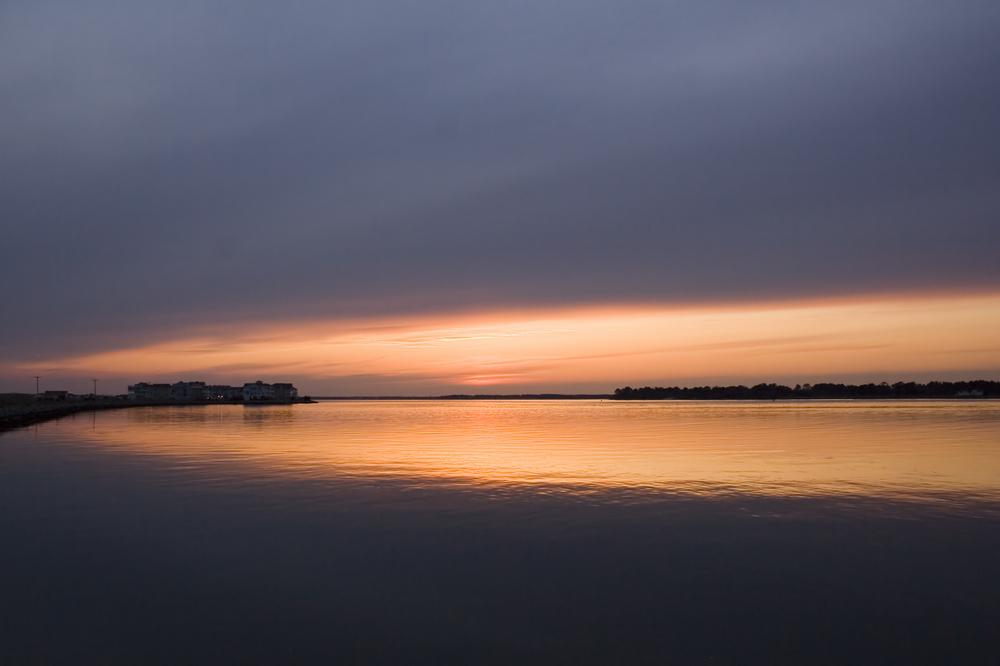Golden sunset at Indian River Inlet in Delaware.