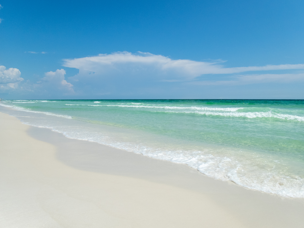 Blue skies, white sands and green waters on Florida's Emerald Coast near Henderson Beach State Park and Destin Florida