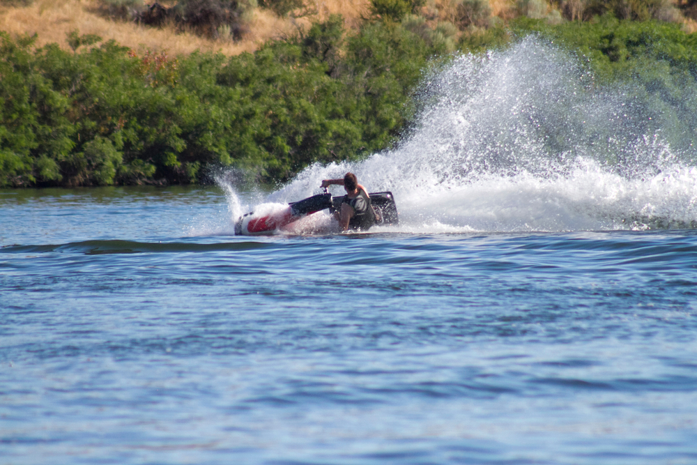Stand Up Jet Ski fun on a hot summer day. Located at Black's Creek in Emmett, Idaho.