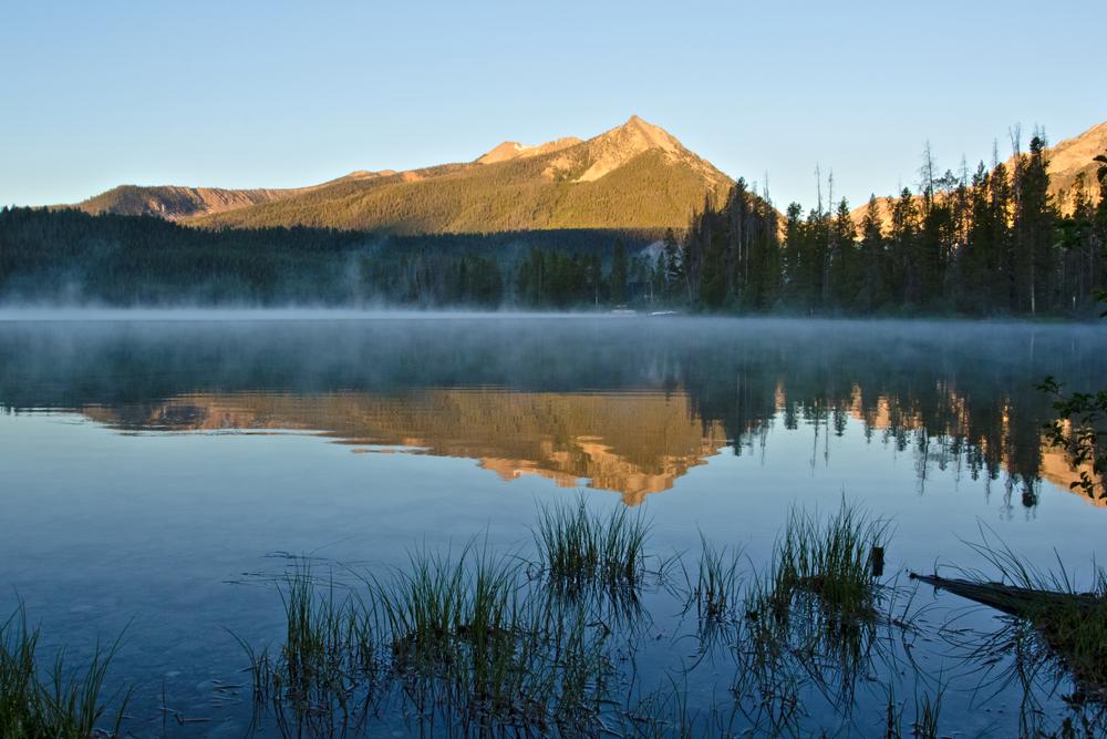morning light on McDonald Peak reflecting in Pettit Lake near Stanley, Idaho