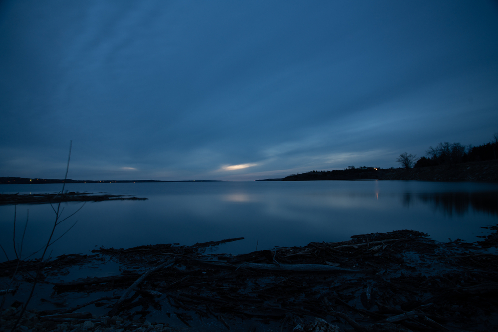 Cloudy sunset over a lake at tuttle creek Kansas.