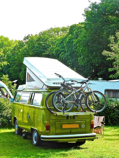 a campervan with bikes on the back set up for the night