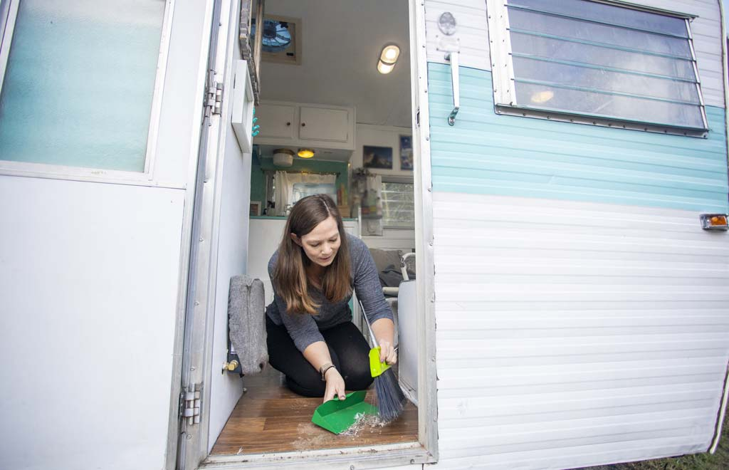 woman cleaning an RV