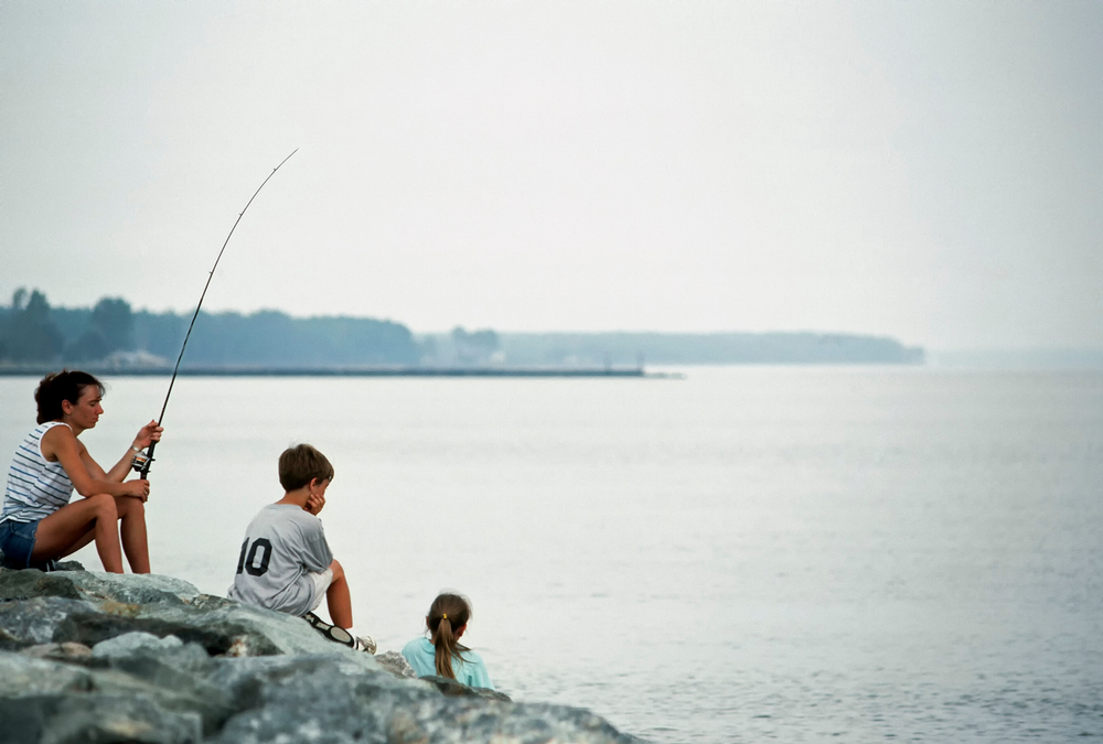 Point Lookout State Park, St Marys County, Maryland, USA, Mother fishing while children play, August 6, 1991