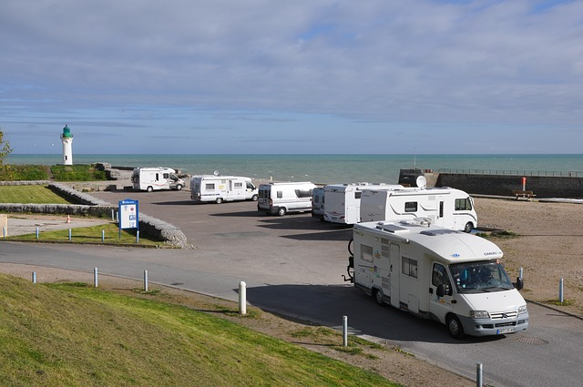 a fleet of RVs at the seaside