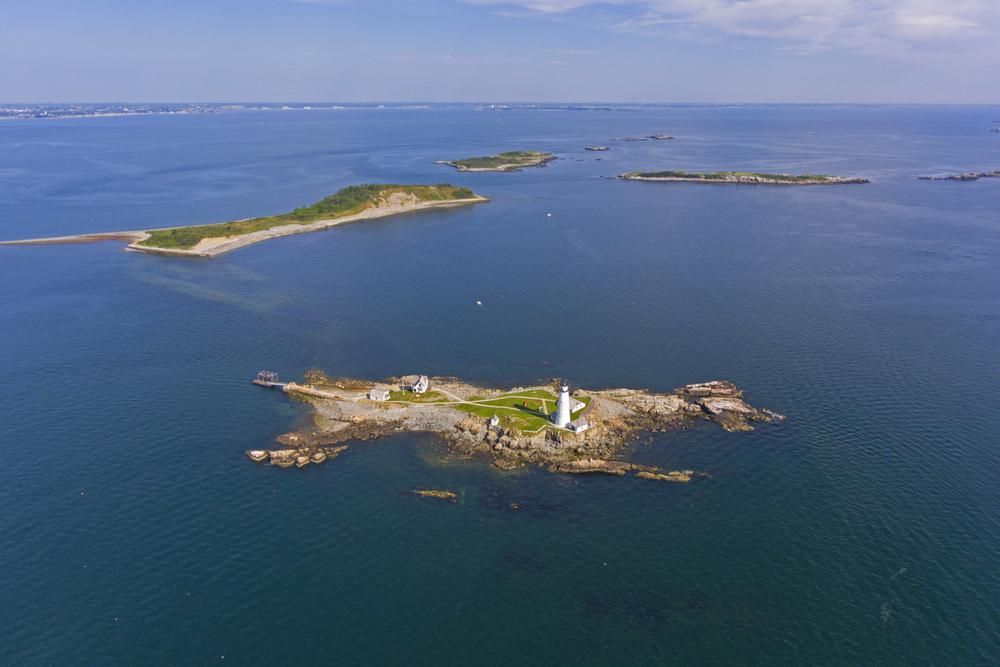 Boston Lighthouse on Little Brewster Island in Boston Harbor, Boston, Massachusetts MA, USA.