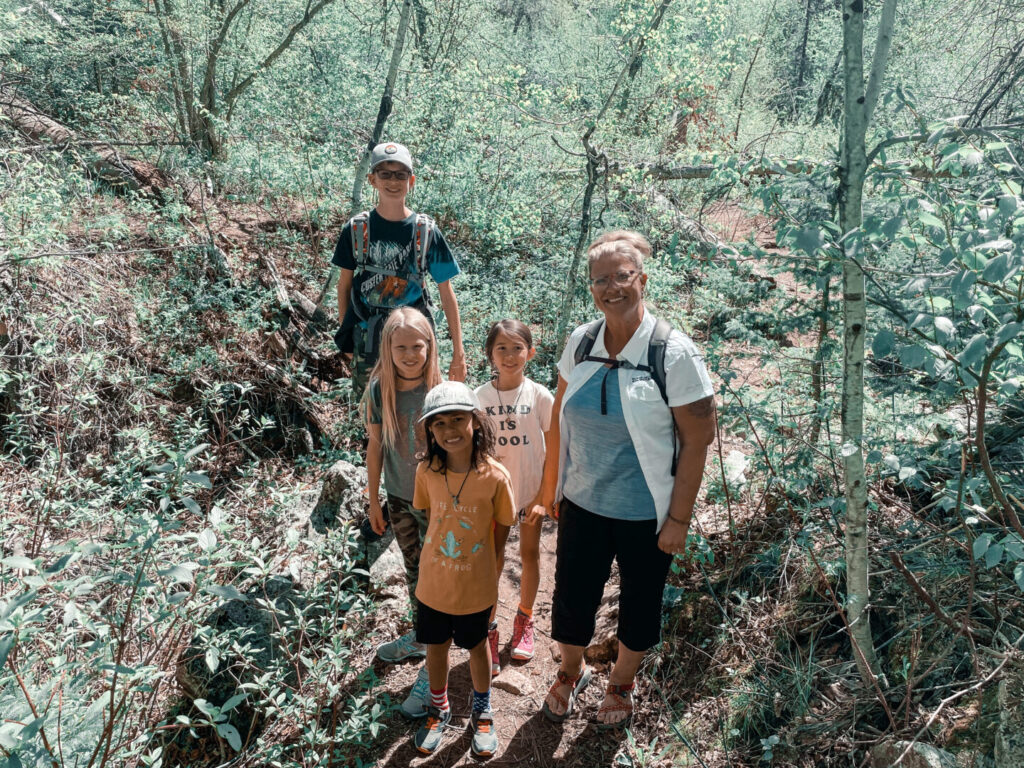 Children and hiking guide pose on the trail