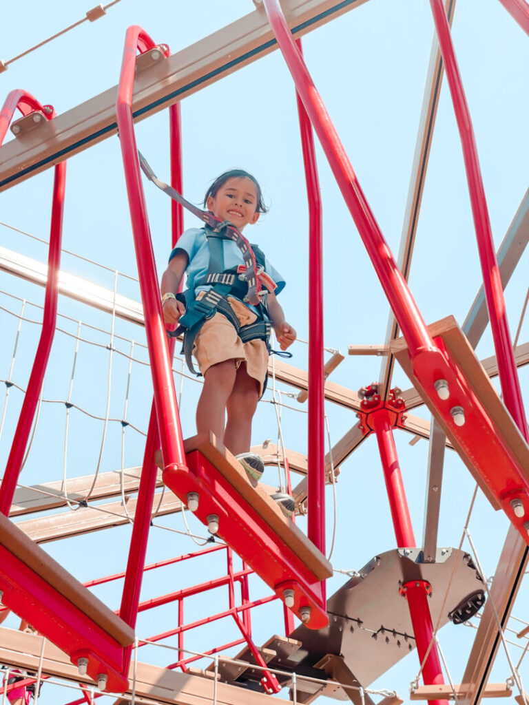Child smiles while on obstacle course
